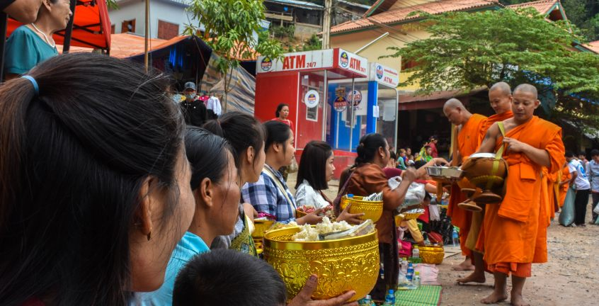 Novice Monks is chanting and blessing local villagers who offered alms