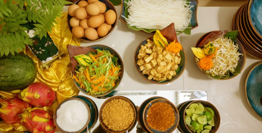 Guests cook their first famous Lao dish Papaya salad